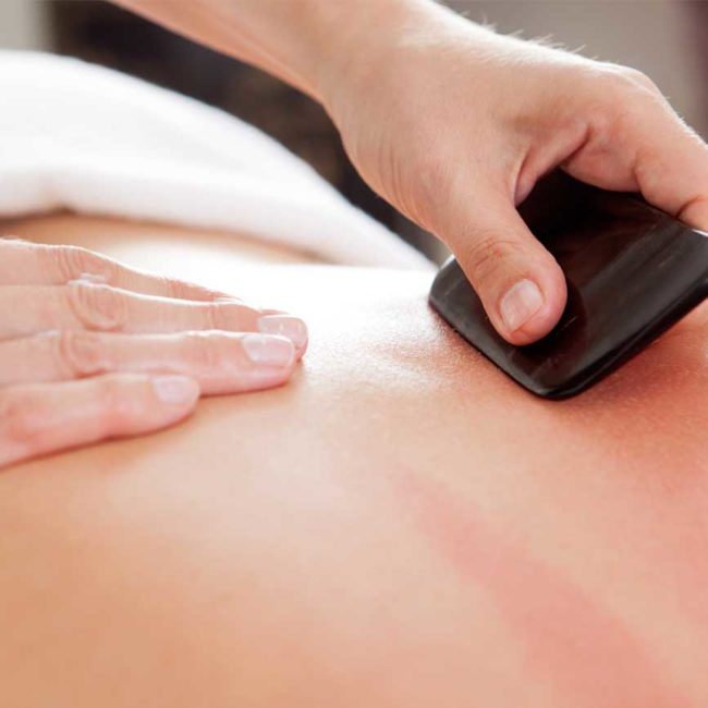 TCM-Therapie Guasha Reibe-Massage