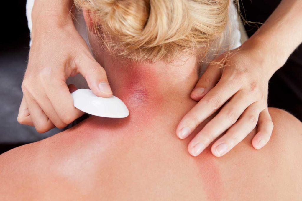 TCM-Therapie Guasha Reibe-Massage